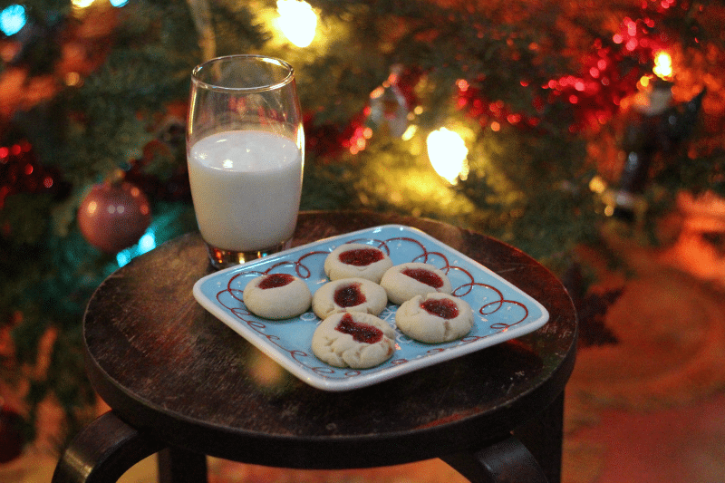 These easy thumbprint cookies are so simple, you'll want to make them with the kids! Buttery cookie dough with a hint of sweet jam makes them perfect for Santa!