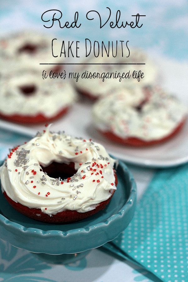 These baked donuts have the rich color and flavor of red velvet, without having to use a ton of red coloring! Super moist and delicious, too!