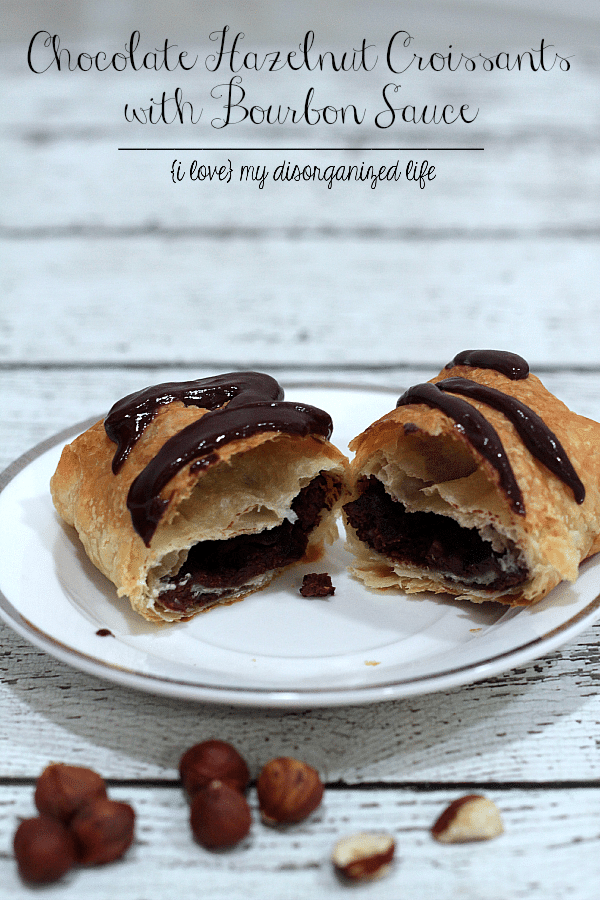 Rich chocolate with bits of hazelnut baked in a flaky croissant and drizzeled with bourbon infused chocolate sauce- heaven!