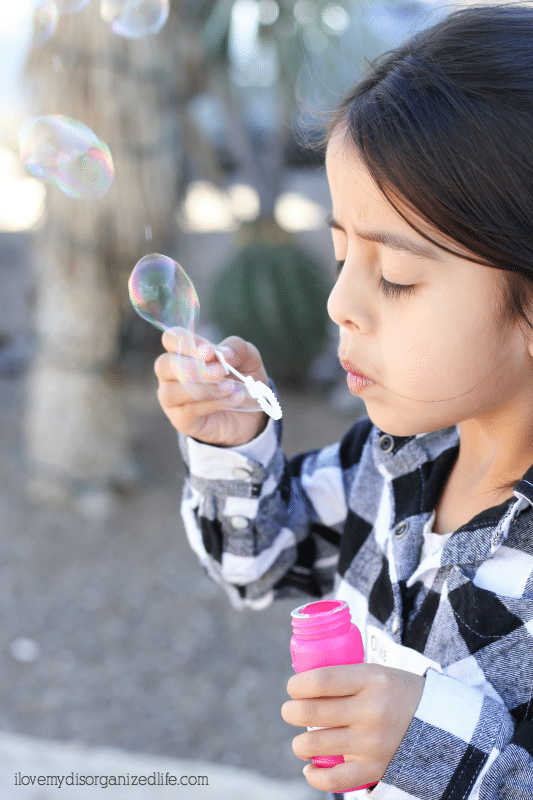 blowing bubbles from a bottle