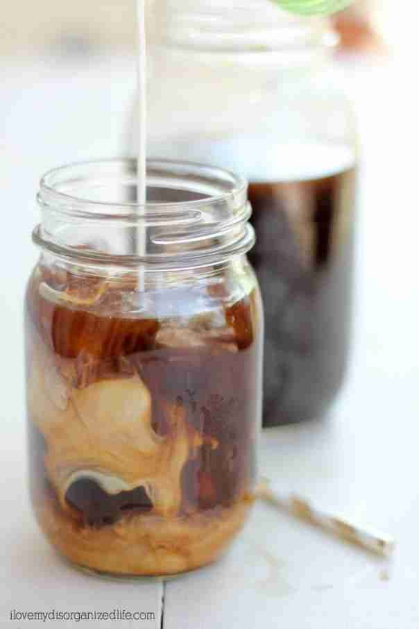 Cold brew coffee with cream in glass