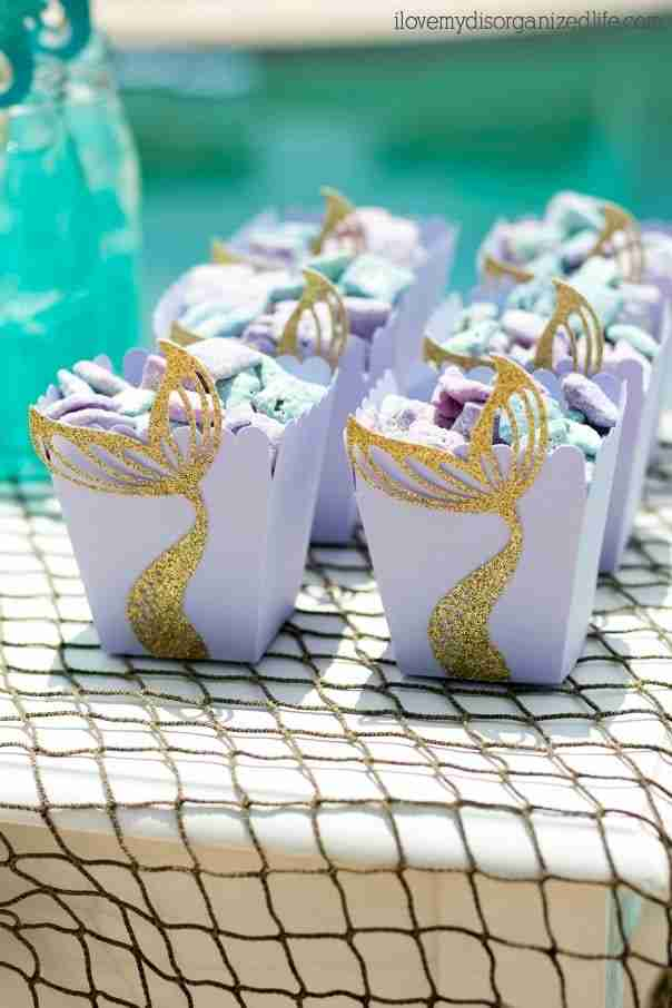 Mermaid DIY treat boxes are easy to make and a great way to add fun to your mermaid party. Perfect for popcorn or puppy chow!