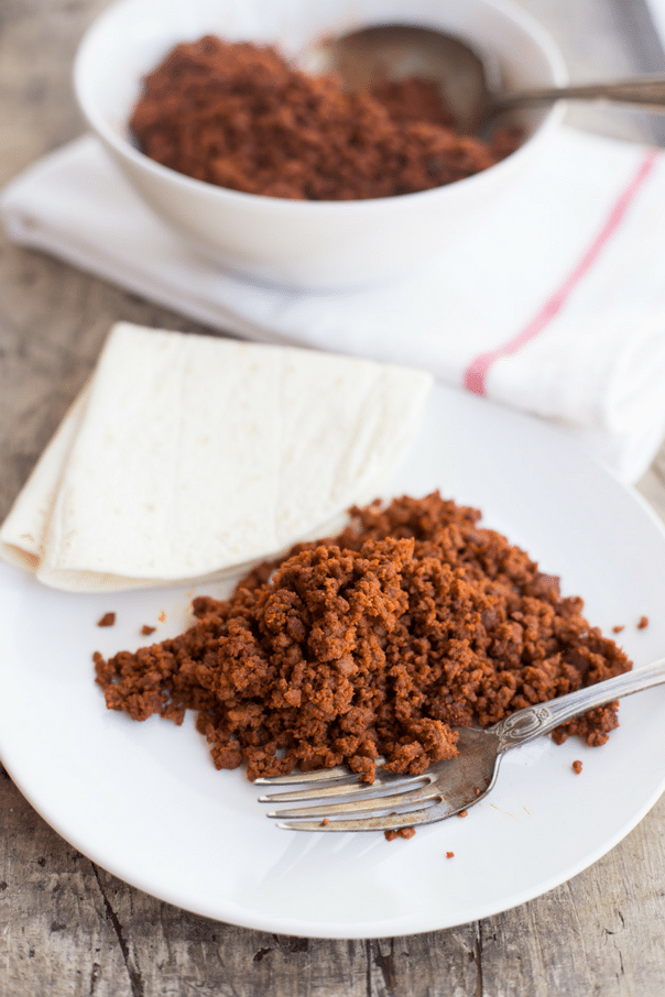 Spicy homemade chorizo is easier to make than you think, with just a few common ingredients and less than 10 minutes! Plus, you can make it as spicy or mild as you want to!