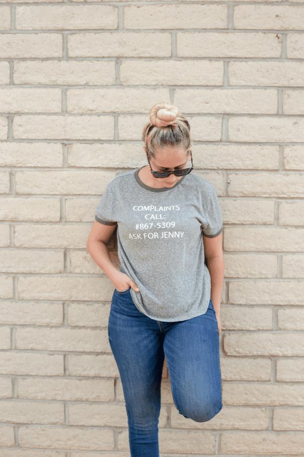 Girl wearing sunglasses and 8675309 T-shirt