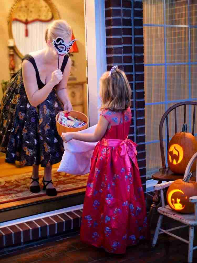 Girl dressed as princess trick-or-treating