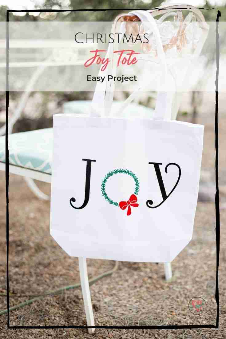 This Christmas joy tote bag is easy to make using your Cricut machine, a pre-made tote bag and free Cricut images! Perfect for shopping or giving as a gift filled with goodies! #Christmas #joytote #DIY