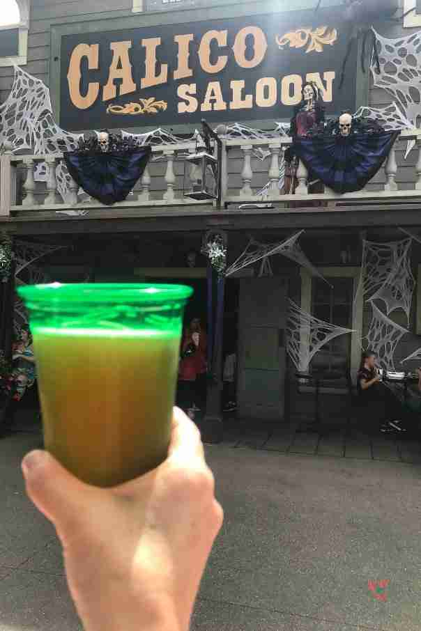 Glass of beer in front of Knott's Berry Farm Calico Saloon