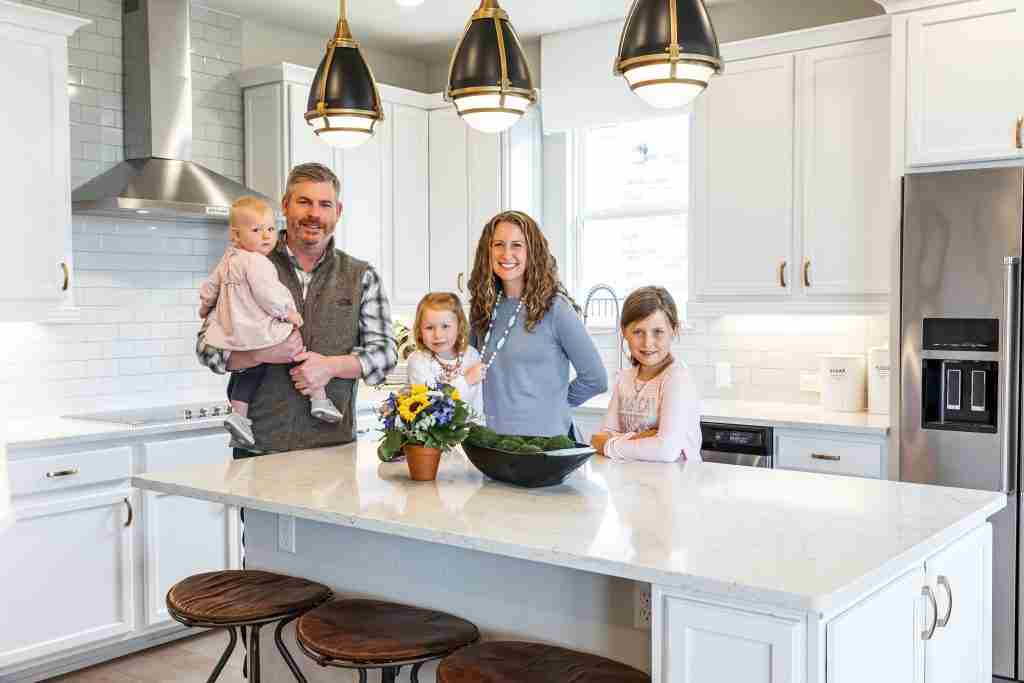 second home in the southwest, family of five in kitchen